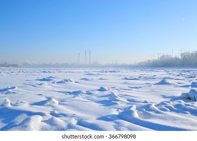 Frozen River Neva at sunny winter day, outskirts of St. Petersburg, Russia.
