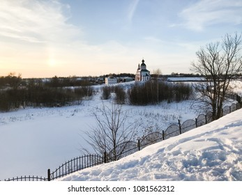 frozen river and view of Church of Elijah the Prophet on Ivanovo Hill (Elijah Church) Suzdal town in winter twilight in Vladimir oblast of Russia