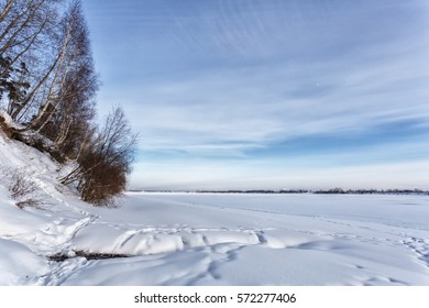 Frozen river in the winter sky, clear day