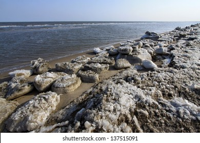 frozen sandy beach natural scenery in a geological park, north china