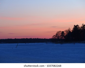 A frozen sea in the red sunset light, Espoo, Finland