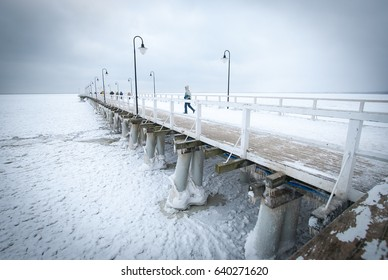 Frozen sea water by the pier