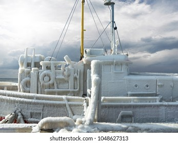 frozen ship in thick ice crust after severe winter storm