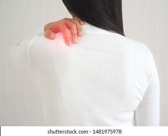 frozen shoulder or adhesive capsulitis in asian woman and she touching her shoulder symptom of pain and stiffness cause of swimming and use for health care concept.