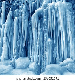frozen small mountain waterfall close up