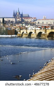Frozen Snowy Prague gothic Castle above the River Vltava with Charles Bridge