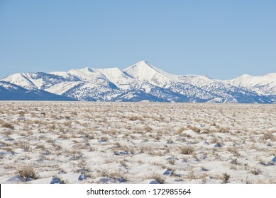 The frozen and snowy sagebrush steppe and white alpine peaks of the Lemhi Valley and Mountain Range in Central Idaho.