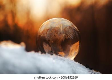 Frozen soap bubble, ice ball.