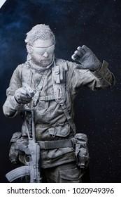 Frozen soldier with pistol in snow