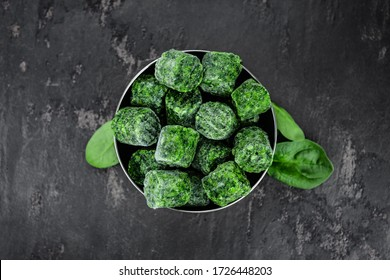 Frozen spinach cubes as detailed close up shot (selective focus)