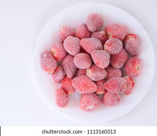 Frozen strawberries on the dish.