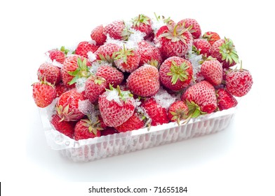 Frozen strawberries in opened box isolated on white