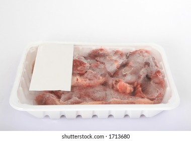Frozen supermarket groceries meat on white, isolated, copy space, close-up, macro.