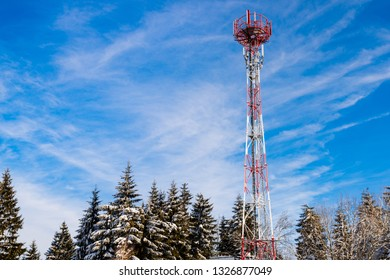 Frozen television or cellular tower with blue sky at sunny day