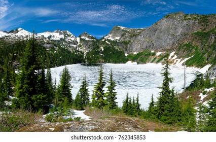 Frozen Thorton Lake and Trappers Peak.  North Cascades National Park, Washington