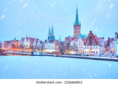 Frozen Trave river and embankment at winter time. Lubeck. Germany