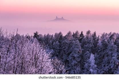 Frozen trees in front of Trosky castle in Czech paradise at sunset, Czech republic