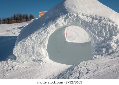 frozen tunnel, snowpark in dolomites mountains, the alps