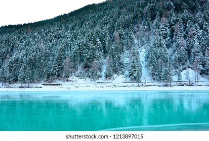 the frozen Turquoise lake, the snow-covered forest