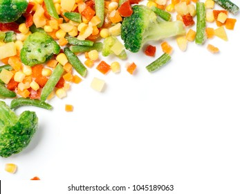 Frozen vegetables assorted isolated on white with clipping path. Frosen vegetables with ice Isolated one edge. Frozen mix vegetables with copy space for text. Top view or flat-lay.