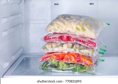 Frozen vegetables in bags in refrigerator