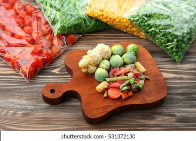 Frozen vegetables on wooden board