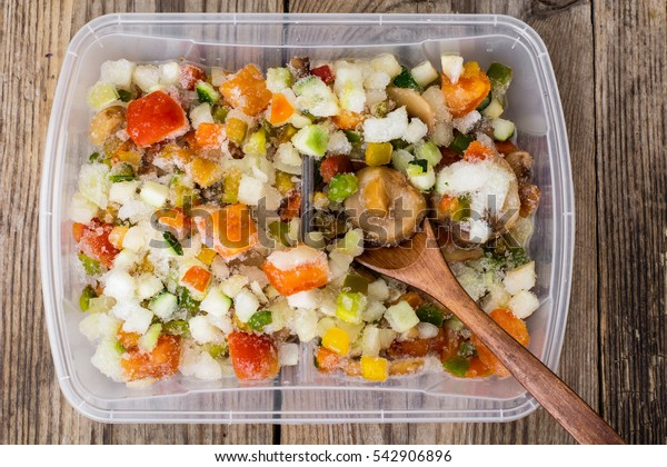 Frozen vegetables in a plastic container. Studio Photo