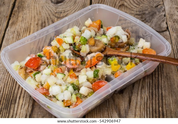 Frozen vegetables in a plastic container. Studio Photo