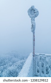 A frozen warning sign on top of the Buchkogelwarte in Burgenland, Austria