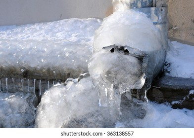 Frozen water in the downspout in the winter in Russia