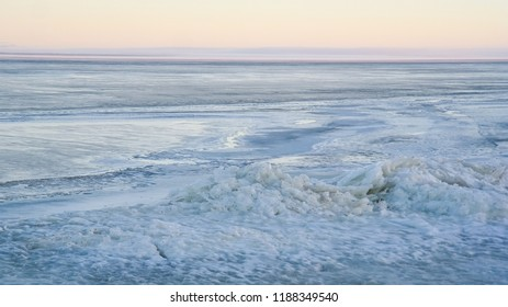 Frozen Water in lagoon. Curonian Spit. Winter evening in Lithuania. Ice. Snow. White