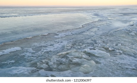 Frozen Water in lagoon. Curonian Spit. Winter evening in Lithuania. Ice. Snow. White. Dangerous to go