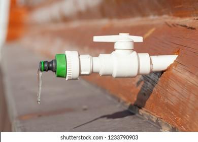 Frozen water in a plastic tap
