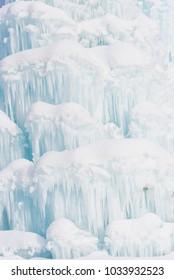Frozen waterfall in dolomites mountains