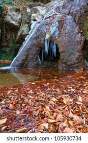 frozen waterfall in a mountain canyon