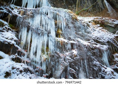 Frozen waterfall on small river in the mountains