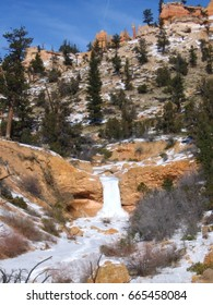 A frozen waterfall stands still and silent in Bryce Canyon's winter wonderland.