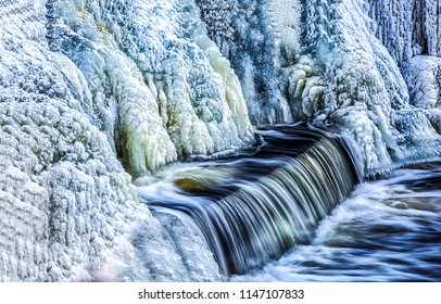 Frozen waterfall water view. Waterfall ice frozen. Frozen waterfall water flow