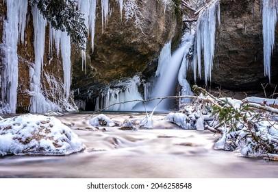 Frozen waterfall in winter scene. Frozen waterfall icilces. Icicles of frozen waterfall