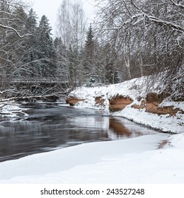Frozen winter river landscape with ice and snow