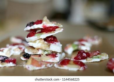 Frozen yogurt bark with various fruit strawberry, banana, nectarine, kiwi, raspberry, blackberry and stevia. Healthy, sugar free and gluten free snack. Selective focus.