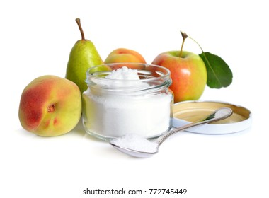 Fructose, or fruit sugar in glass jar. With fruit. Isolated.