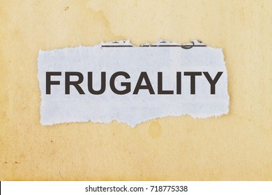 Frugality newspaper cutout in an old paper background.