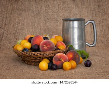 Fruit and ale. Old fashioned fruit from a long abandoned orchard with pewter tankard. Still life.