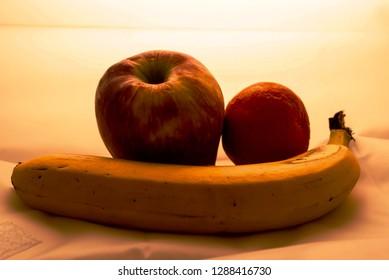 Fruit: apple, banana and mandarin