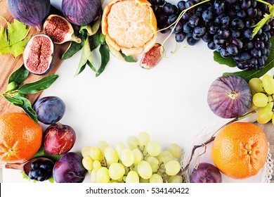 Fruit Background with Grape, Plum, Tangerines, Figs on White Paper. Healthy Food Frame