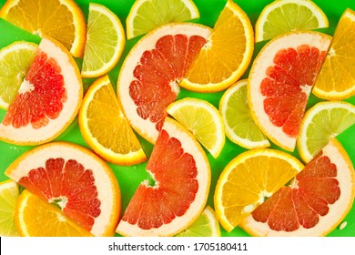 fruit background, a mixture of slices of citrus fruits, a vitamin set of fruits, healthy natural products. Juicy ripe orange, lemon and grapefruit.