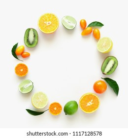 Fruit background. Summer concept. Colorful fresh citrus fruit on a light pastel background table. Orange, tangerine, lime, kiwi. Flat lay, top view, copy space