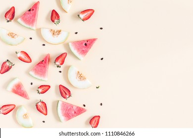 Fruit background. Watermelon, melon, strawberry on pastel yellow background. Summer concept. Flat lay, top view, copy space
