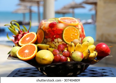 Fruit Basket with a Big Portion of Drink of Mango, Grapes, Royal Bananas, Apples, Dragon Fruits, and Oranges